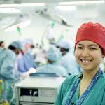 Woman smiling at camera in hospital surgery