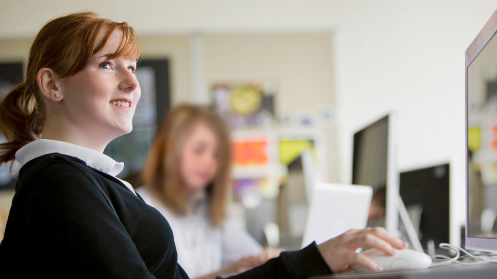Smiling pupils in computer lesson